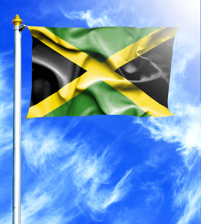 mast: Blue sky and mast with hanged waving flag of Jamaica