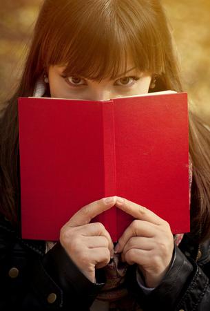 preety: Beautiful girl hiding behind the book