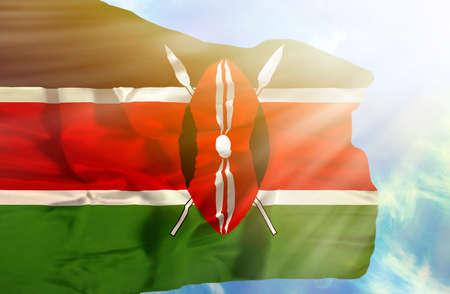 sunrays: Kenya waving flag against blue sky with sunrays
