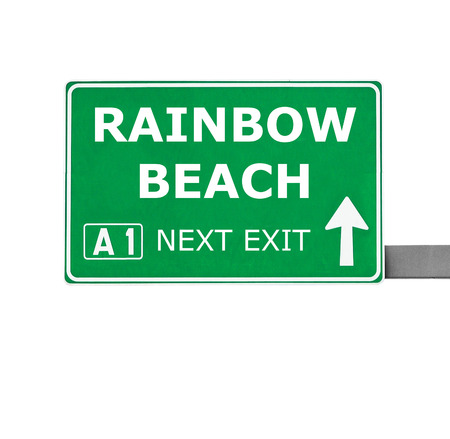 chill out: RAINBOW BEACH road sign isolated on white