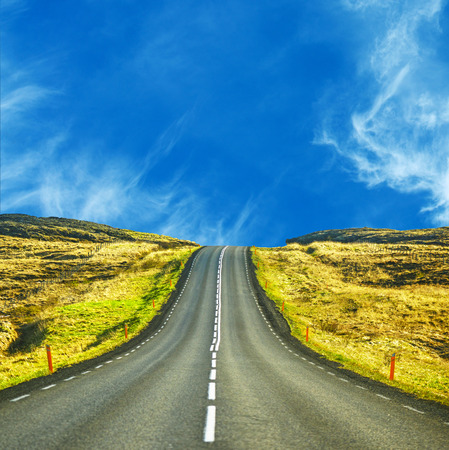 country road: Beautiful landscape with vanishing higway on sunny day
