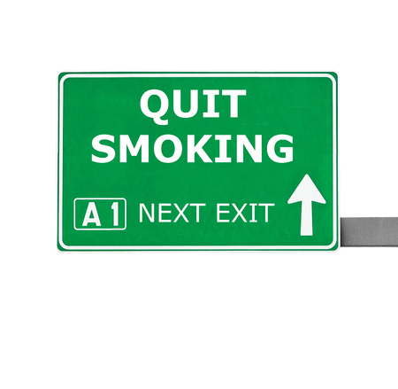 quit smoking: QUIT SMOKING road sign isolated on white