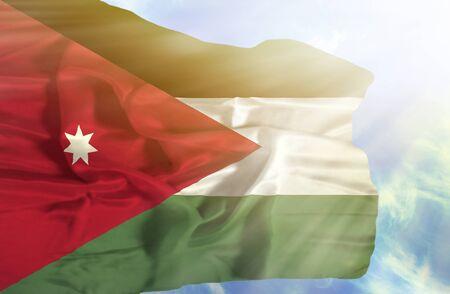 sunrays: Jordan waving flag against blue sky with sunrays