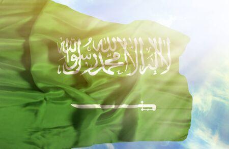 3d flag: Saudi Arabia waving flag against blue sky with sunrays Stock Photo