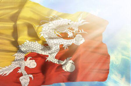 bhutan: Bhutan waving flag against blue sky with sunrays
