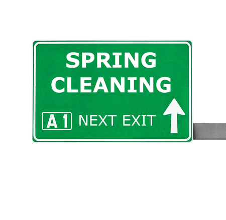 spring cleaning: SPRING CLEANING road sign isolated on white