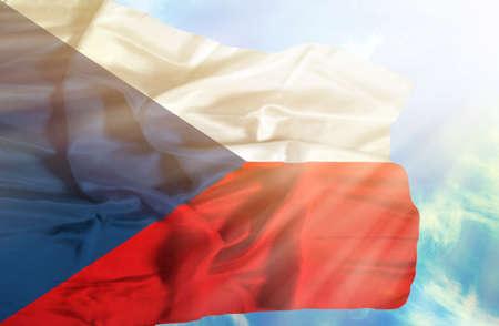 the czech republic: Czech Republic waving flag against blue sky with sunrays Stock Photo