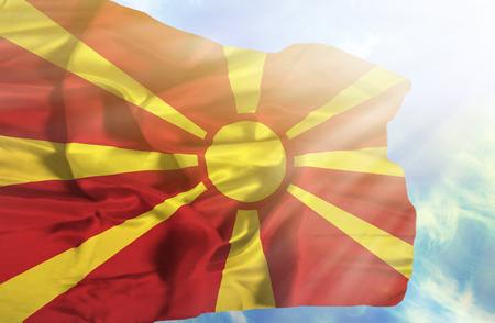 sunrays: Macedonia waving flag against blue sky with sunrays