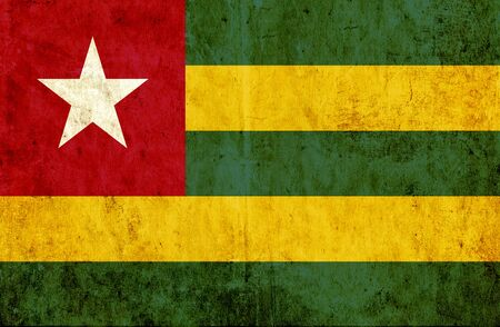 run down: Grungy paper flag of Togo Stock Photo