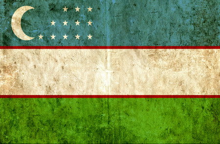 run down: Grungy paper flag of Uzbekistan