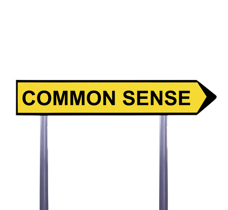 common sense: Conceptual arrow sign isolated on white - COMMON SENSE Stock Photo