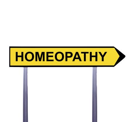 homeopatia: muestra de la flecha conceptual aislado en blanco - HOMEOPAT�A