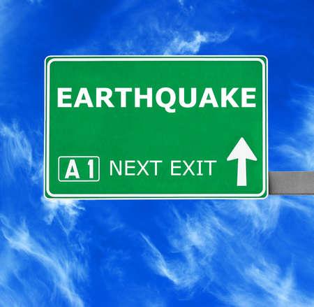 convulsion: EARTHQUAKE  road sign against clear blue sky Foto de archivo