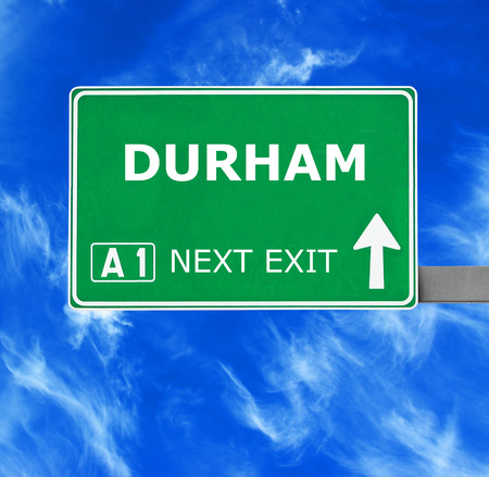 durham: DURHAM road sign against clear blue sky Stock Photo
