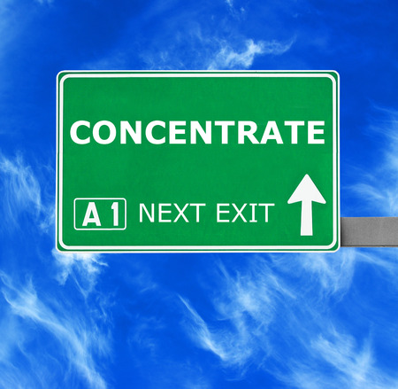 concentrate: CONCENTRATE road sign against clear blue sky Stock Photo
