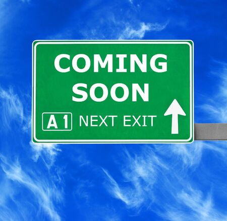 anticipated: COMING SOON road sign against clear blue sky
