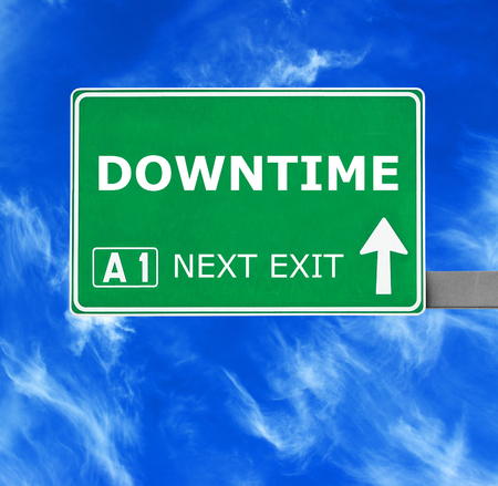 downtime: DOWNTIME road sign against clear blue sky Stock Photo