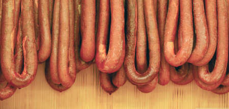 larder: Smoked sausages meat hanging in domestic smokehouse