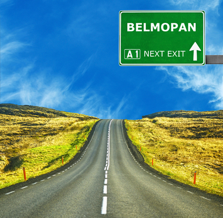 tourism in belize: BELMOPAN road sign against clear blue sky
