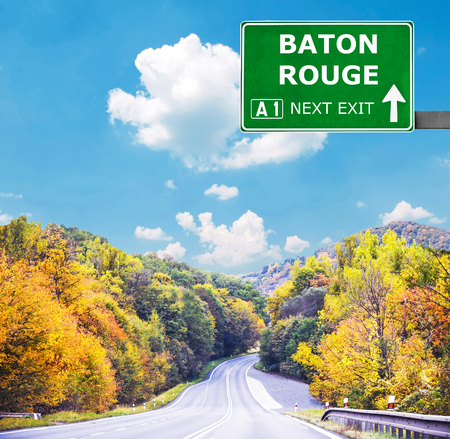 rouge: BATON ROUGE road sign against clear blue sky Stock Photo