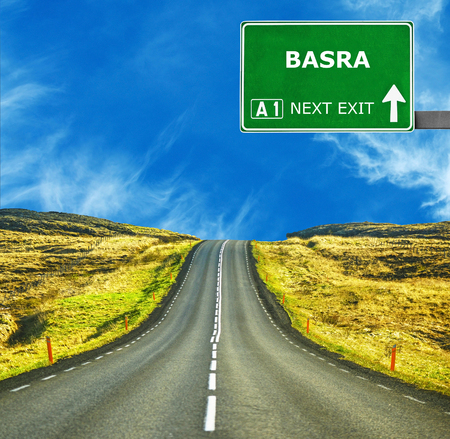 BASRA road sign against clear blue sky Stock Photo