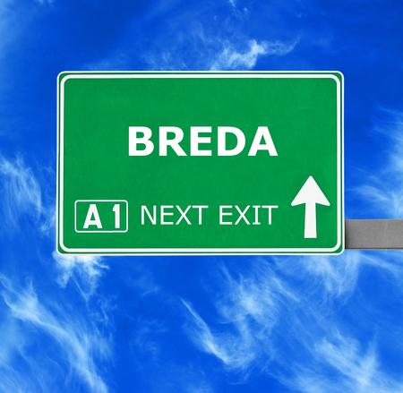 breda: BREDA road sign against clear blue sky Stock Photo