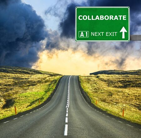 joining forces: COLLABORATE road sign against clear blue sky Stock Photo