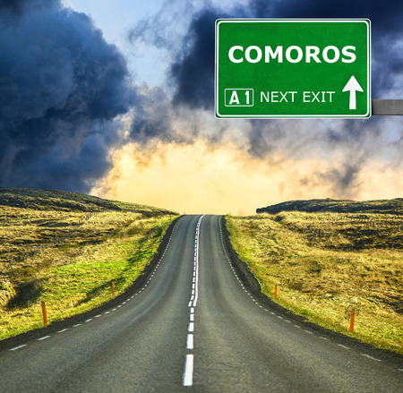 comoros: COMOROS road sign against clear blue sky