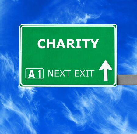 benevolence: CHARITY road sign against clear blue sky