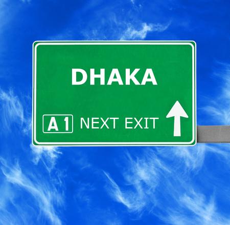 dhaka: DHAKA road sign against clear blue sky Stock Photo
