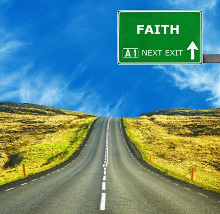 promised: FAITH road sign against clear blue sky
