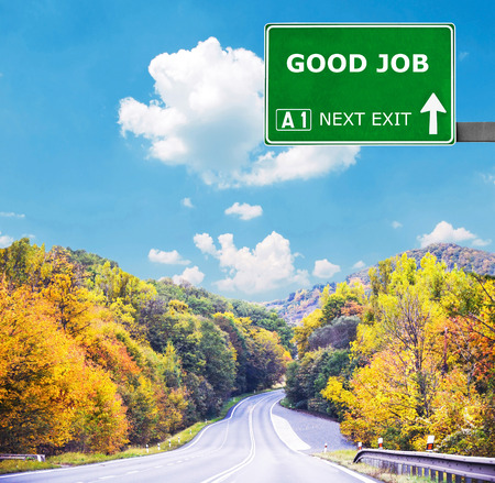 kudos: GOOD JOB road sign against clear blue sky Stock Photo