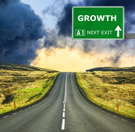 GROWTH road sign against clear blue sky
