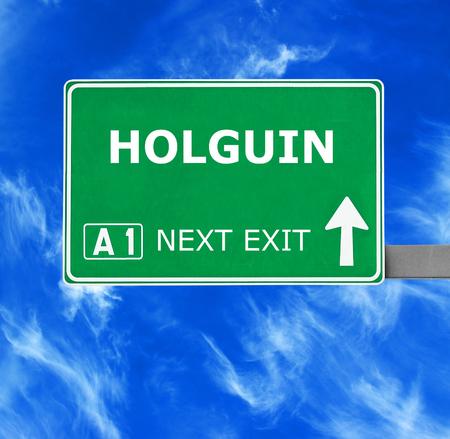 holguin: HOLGUIN road sign against clear blue sky Stock Photo
