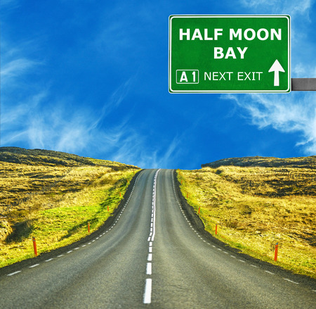 chill out: HALF MOON BAY road sign against clear blue sky