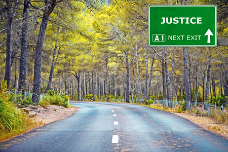 justness: JUSTICE road sign against clear blue sky