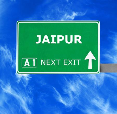jaipur: JAIPUR road sign against clear blue sky Stock Photo