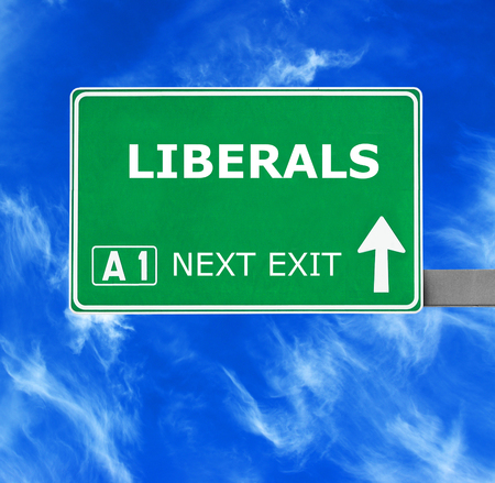 LIBERALS road sign against clear blue sky
