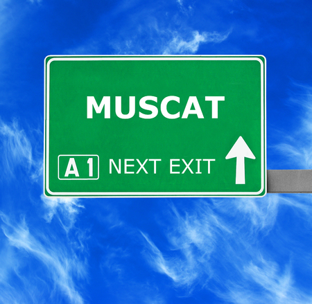 muscat: MUSCAT road sign against clear blue sky