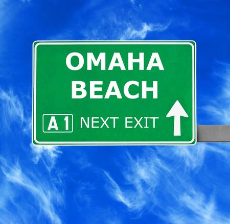 omaha: OMAHA BEACH road sign against clear blue sky