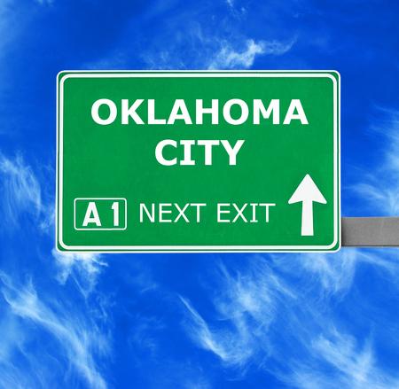 oklahoma city: OKLAHOMA CITY road sign against clear blue sky