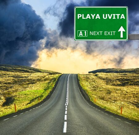 chill out: PLAYA UVITA road sign against clear blue sky Stock Photo