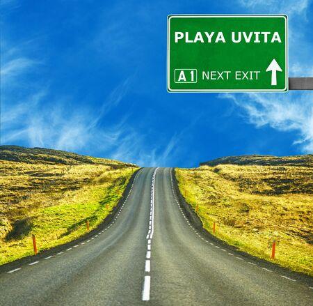 playa: PLAYA UVITA road sign against clear blue sky Stock Photo