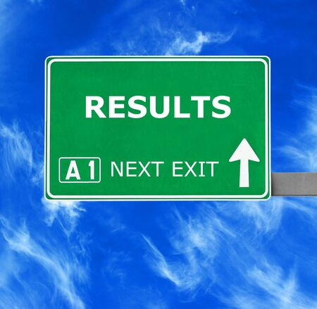conclusions: RESULTS road sign against clear blue sky Stock Photo