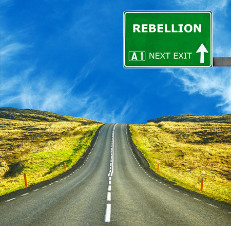 rebellion: REBELLION road sign against clear blue sky