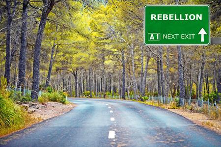 rebellion: REBELLION road sign against clear blue sky