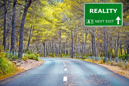 actuality: REALITY road sign against clear blue sky Stock Photo
