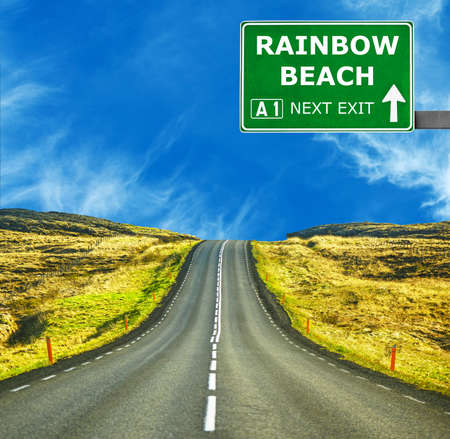 chill out: RAINBOW BEACH road sign against clear blue sky Stock Photo