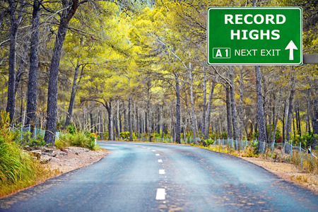 highs: RECORD HIGHS road sign against clear blue sky Stock Photo