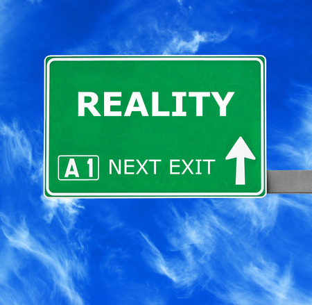 crux: REALITY road sign against clear blue sky Stock Photo